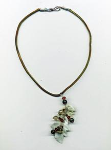 A cascade of Mother of Pearl leaves with a pallette of fall colored gemstones and Swarovksi crystal hanging from a hand dyed silk cord necklace.