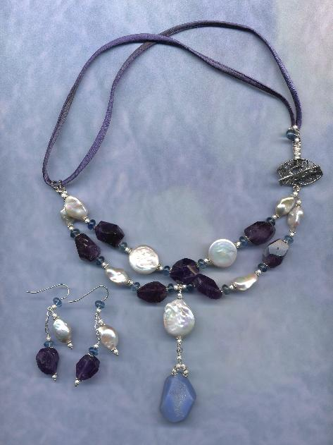 Large Chalcedony Drusy with rare large coin pearls, amethyts and Iolites.